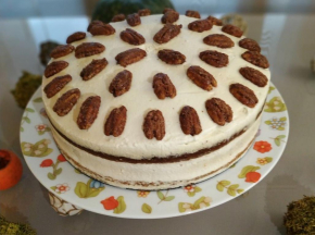 Pumpkin spice cake with maple cream cheese and crunchy candied pecans